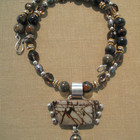 Picture jasper pendent with fresh water pearl on picture jasper and smokey quarts beads with 18kt vermay gold spacers