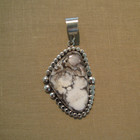 White buffalo with sterling silver pendent.